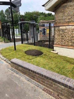 new turf at front of station